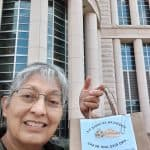 Sr. Dolores Sanchez, OSF, delivering apple pie and rice and beans to a Congressperson's office